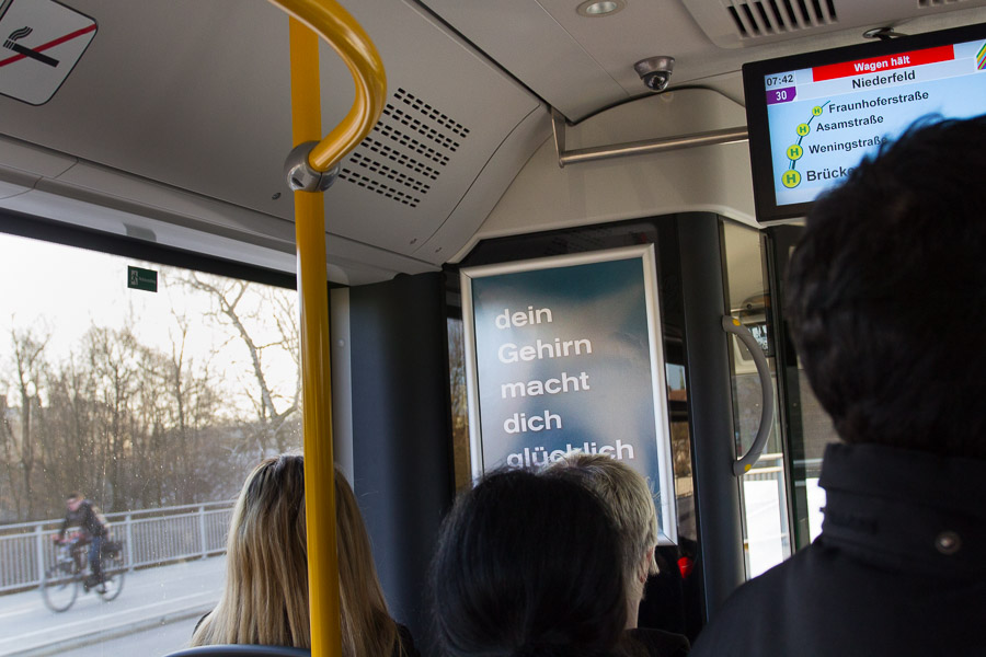 Poster in buses of the INVG Ingolstadt: Your Brain Makes You Happy